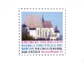 Stamp layout 'Kirchburg von Birthälm' (stamp series 'World Heritage Germany') for United Nations Postal Administration / © Gabriele Franziska Götz